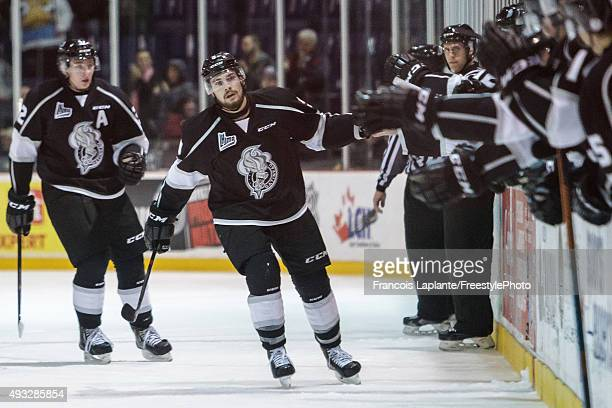 Yan Pavel Laplante of the Gatineau Olympiques celebrates his third period goal at the bench with teammates against the Saint John Sea Dogs on October...