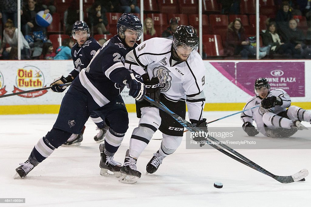 Yan Pavel Laplante #9 of the Gatineau Olympiques controls the puck as Simon Bourque #24 of the Rimouski Oceanic defends on February 22, 2015 at Robert Guertin Arena in Gatineau, Quebec, Canada.