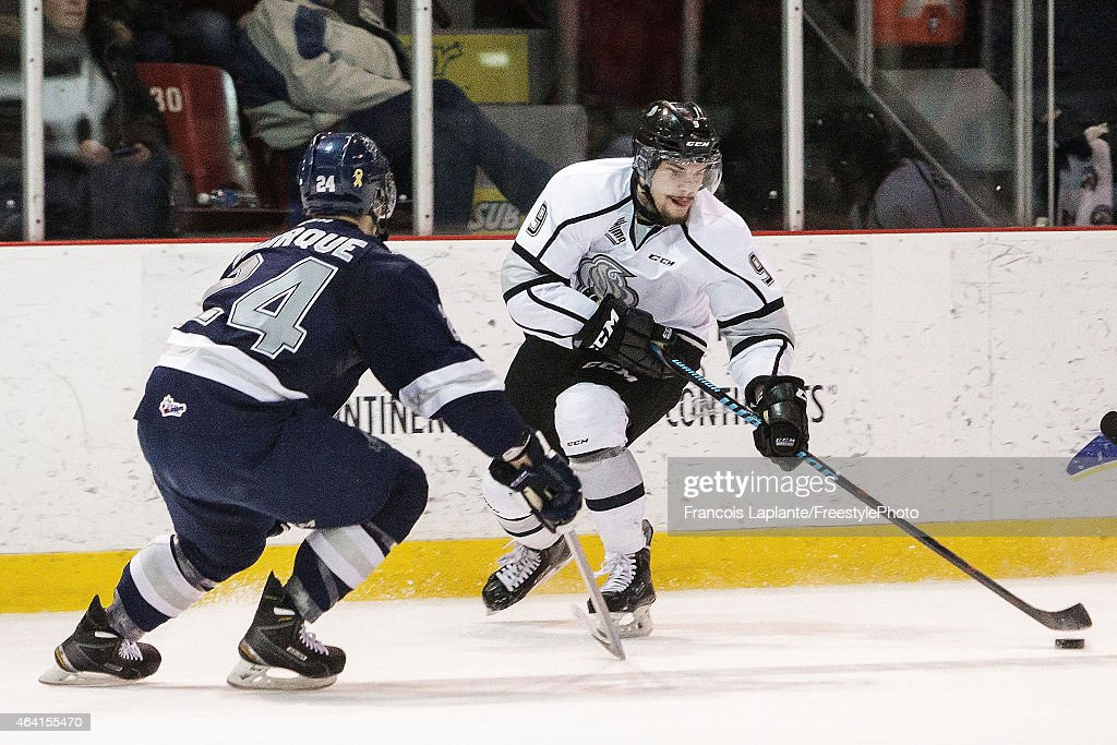 Yan Pavel Laplante #9 of the Gatineau Olympiques controls the puck against Simon Bourque #24 of the Rimouski Oceanic on February 22, 2015 at Robert Guertin Arena in Gatineau, Quebec, Canada.