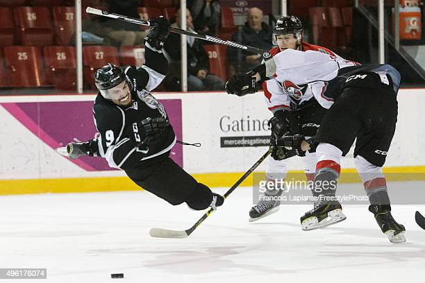 Yan Pavel Laplante of the Gatineau Olympiques goes airborne after a slew foot from Nicolas PatryGingras of the Drummondville Voltigeurs on November 7...