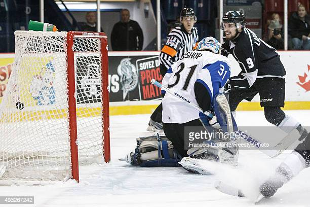 Yan Pavel Laplante of the Gatineau Olympiques puts the puck past Alex Bishop of the Saint John Sea Dogs in a break away on October 18 2015 at Robert...