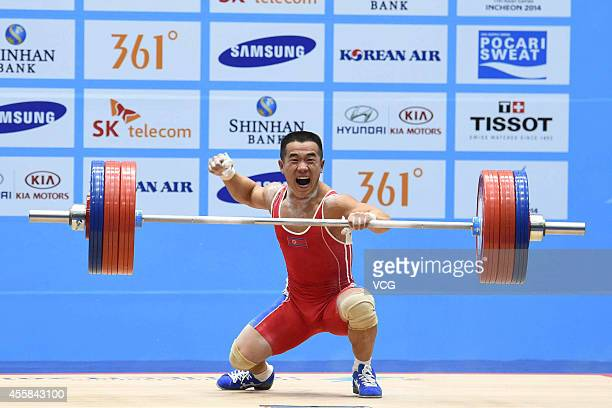 Yan Runzhe of China competes in men's 56kg weightlifting during day one of the 2014 Asian Games at Moonlight Festival Garden Weightlifting Venue on...