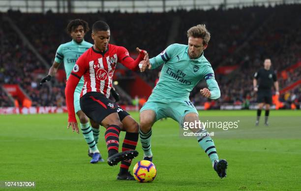 Yan Valery of Southampton and Nacho Monreal of Arsenal during the Premier League match between Southampton FC and Arsenal FC at St Mary's Stadium on...