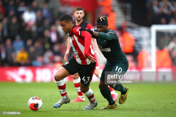 Yan Valery of Southampton battles for possession with Allan SaintMaximin of Newcastle United during the Premier League match between Southampton FC...