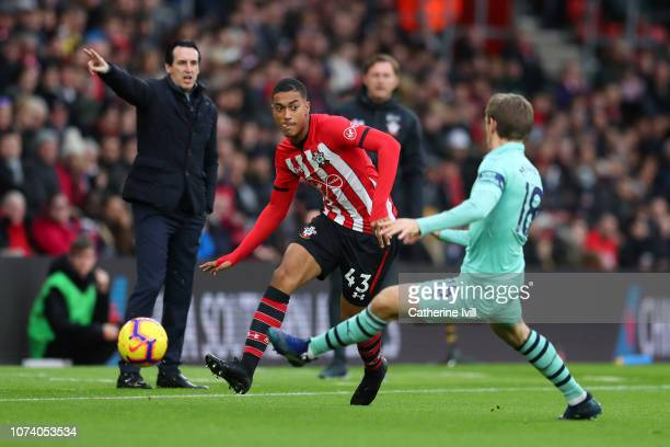 Yan Valery of Southampton passes the ball under pressue from Nacho Monreal of Arsenal during the Premier League match between Southampton FC and...