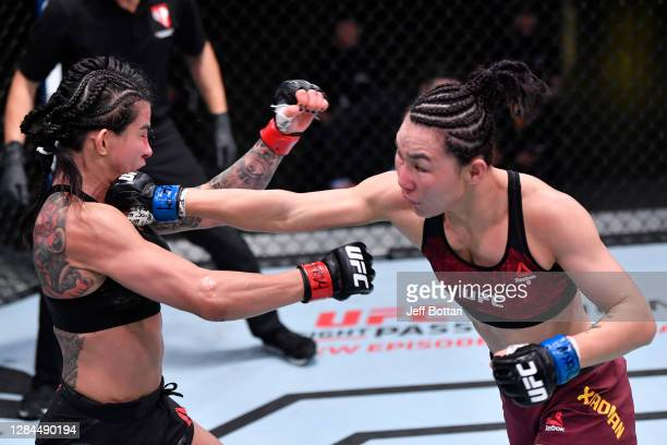 Yan Xiaonan of China punches Claudia Gadelha of Brazil in a strawweight fight during the UFC Fight Night event at UFC APEX on November 07, 2020 in...
