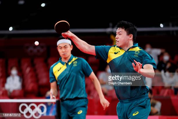 Yan Xin and Hu Heming of Team Australia in action during their Men's Team Round of 16 table tennis match on day ten of the Tokyo 2020 Olympic Games...