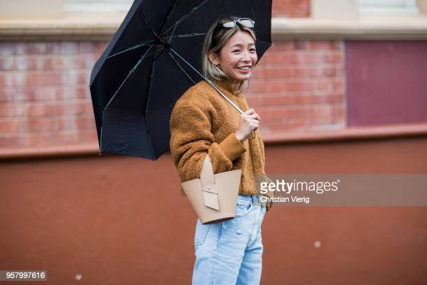 Yan Yan Chan wearing brown teddy jacket light denim jeans bucket bag is seen outside Camilla and Marc during MercedesBenz Fashion Week Resort 19...