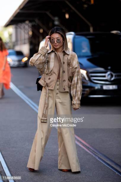 Yan Yan Chan wearing Zimmermann jacket Louis Vuitton handbag and Staud pants at MercedesBenz Fashion Week Resort 20 Collections on May 15 2019 in...