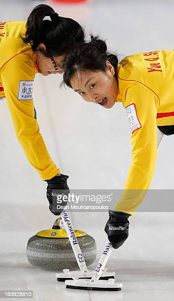 Yan Zhou and Yue Qingshuang of China sweep in the match between Scotland and China during Day 3 of the Titlis Glacier Mountain World Women's Curling...