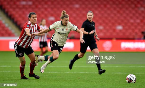 Yana Daniels of Liverpool Women competing with Georgia Robert of Sheffield United Women during the Barclays FA Women's Championship match between...