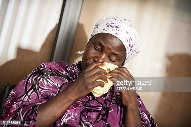 Yana Galang the mother of Rifkatu Galang one of the abducted Chibok girls wipes tears from her cheek during an interview in Lagos on April 5 2016 On...