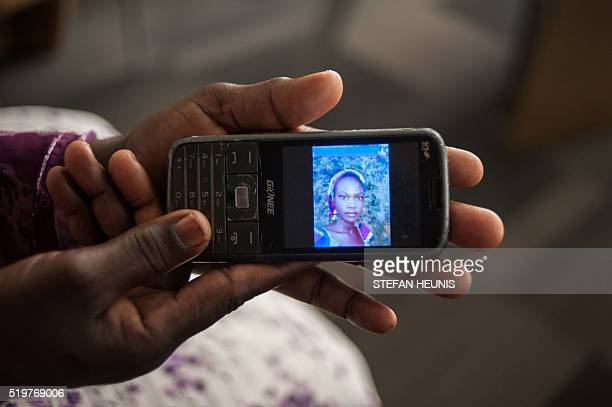 Yana Galang the mother of Rifkatu Galang one of the abducted Chibok girls holds a phone with a picture of her daughter during an interview in Lagos...
