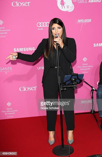 Yana Gercke sings during the CLOSER Magazin Hosts SMILE Award 2014 at Hotel Vier Jahreszeiten on November 4 2014 in Munich Germany