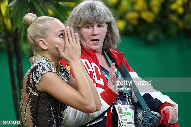 Yana Kudryavtseva of reacts after dropping a club during the Women's Individual AllAround Rhythmic Gymnastics Final on Day 15 of the Rio 2016 Olympic...