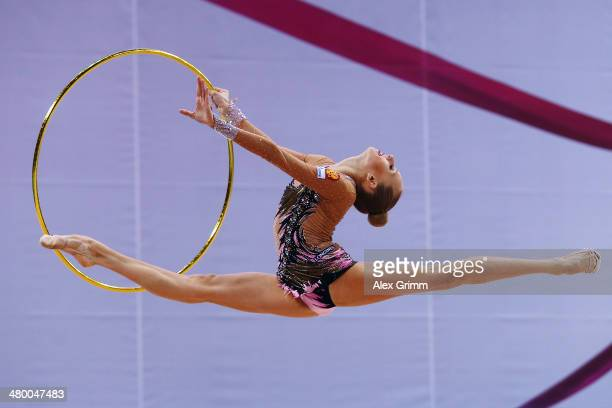 Yana Kudryavtseva of Russia performs with the hoop during the GAZPROM World Cup Rhythmic Gymnastics at Porsche Arena on March 22 2014 in Stuttgart...