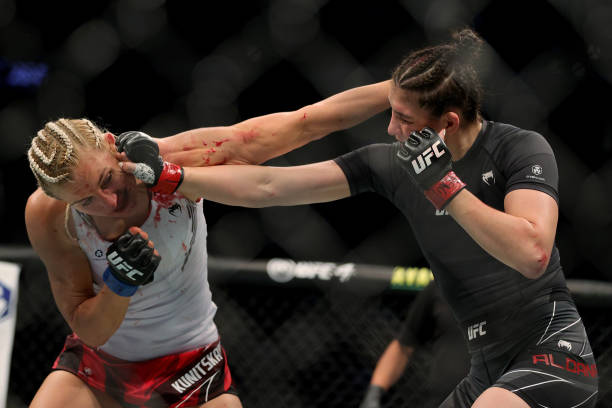 Yana Kunitskaya of Russia and Irene Aldana of Mexico exchange punches in the first round in their catchweight bout during UFC 264: Poirier v McGregor...