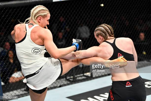 Yana Kunitskaya of Russia kicks Aspen Ladd in their women's bantamweight bout during the UFC Fight Night event at Capital One Arena on December 07...