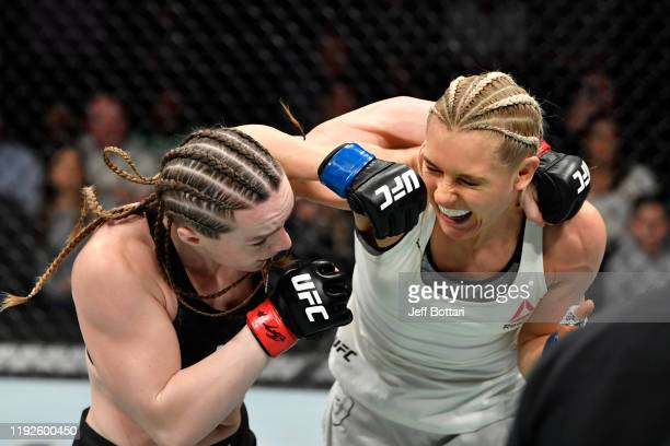 Yana Kunitskaya of Russia punches Aspen Ladd in their women's bantamweight bout during the UFC Fight Night event at Capital One Arena on December 07...