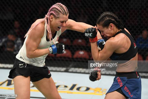 Yana Kunitskaya of Russia punches Marion Reneau in their women's bantamweight bout during the UFC Fight Night event at Intrust Bank Arena on March 9...