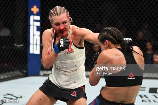 Yana Kunitskaya of Russia punches Marion Reneau in their women's bantamweight bout during the UFC Fight Night event at Intrust Bank Arena on March 9,...