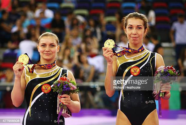 Yana Pavlova and Anna Kornetskaya of Russia stand on the podium during the medal ceremony for the Women's Synchronised Trampoline final on day nine...
