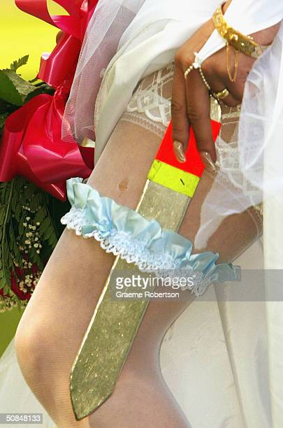 Yana Rodinova assistant to knife thrower Jayde Hanson shows off her garter with a knife in it at their wedding on May 17 2004 in Brighton England...