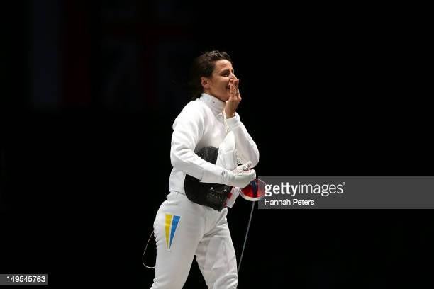 Yana Shemyakina of Ukraine celebrates defeating Britta Heidemann of Germany to win the Gold medal bout in the Women's Epee Individual Fencing Finals...