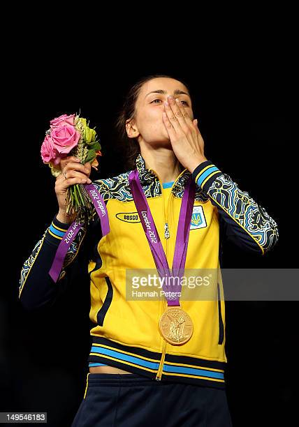 Yana Shemyakina of Ukraine poses with the Gold medal after defeating Britta Heidemann of Germany in the Women's Epee Individual Fencing Finals on Day...