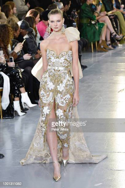 Yana Trufanova walks the runway during the Elie Saab Haute Couture Spring/Summer 2020 show as part of Paris Fashion Week on January 22, 2020 in...