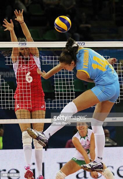 Yana Yagodina of Kazakhstan spikes the ball as Tsvetelina Zarkova of Bulgaria blocks during the FIVB Women's World Championship pool F match between...