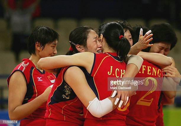 Yanan Liu hugs teammate Jing Chen of China after winning the gold medal by defeating Russia in the women's indoor Volleyball gold medal match on...