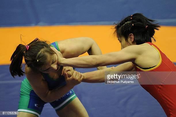 Yanan Sun of China competes against Dauletbike Yakhshimuratova of Uzbekistan in the Women's Freestyle Senior 48 kg quarterfinal match during the 2016...