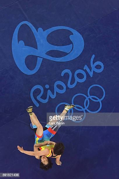 Yanan Sun of China competes against Zhuldyz Eshimova of Kazakhstan during a Women's Freestyle 48kg Bronze Medal bout on Day 12 of the Rio 2016...