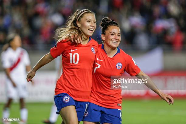 Yanara Aedo and Maria Josa Alondra Rojas Pino of Chile's national football team celebrate a scoring goal during the first phase and qualified for the...