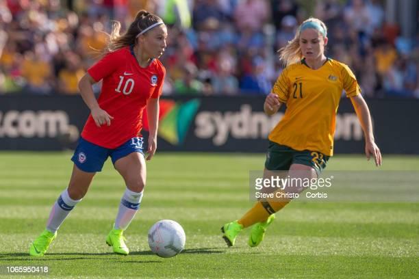 Yanara Aedo of Chile dribbles past Matildas Ellie Carpenter during the International Friendly match between the Australian Matildas and Chile at...