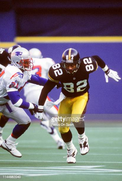 Yancey Thigpen of the Pittsburgh Steelers pushes off Ty Law of the New England Patriots to run a pass rout during an NFL Football game December 16,...