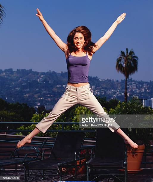 yancy butler jumping in purple top - yancy butler stock pictures, royalty-free photos & images