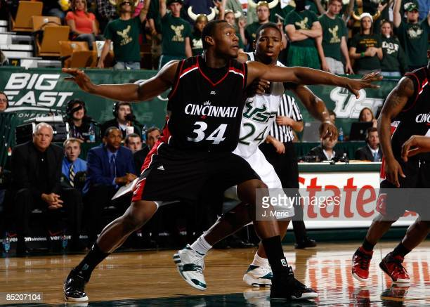 Yancy Gates of the Cincinnati Bearcats boxes out Augustus Gilchrist of the South Florida Bulls during the game at the SunDome on March 3 2009 in...