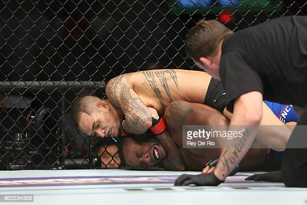 Yancy Medeiros chokes Sean Spencer during the UFC 203 event at Quicken Loans Arena on September 10 2016 in Cleveland Ohio