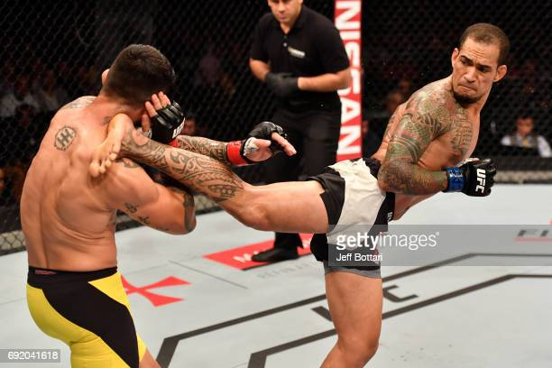 Yancy Medeiros kicks Erick Silva of Brazil in their welterweight bout during the UFC 212 event at Jeunesse Arena on June 3 2017 in Rio de Janeiro...