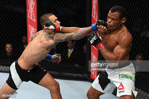 Yancy Medeiros punches Francisco Trinaldo of Brazil in their lightweight bout during the UFC 198 event at Arena da Baixada stadium on May 14, 2016 in...