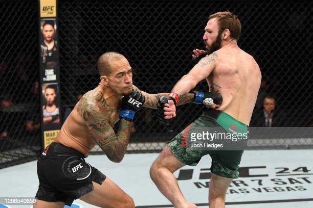 Yancy Medeiros punches Lando Vannata in their lightweight bout during the UFC Fight Night event at Santa Ana Star Center on February 15, 2020 in Rio...