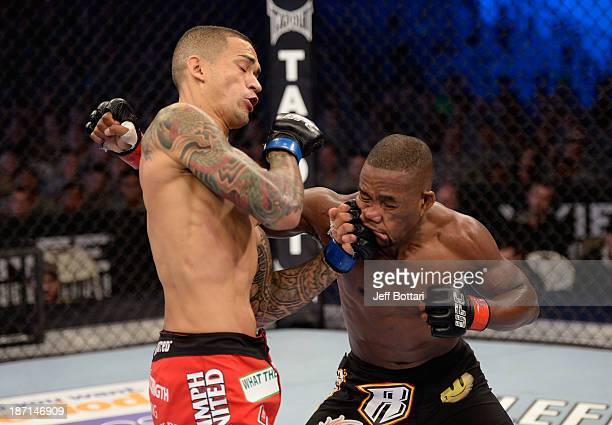 Yancy Medeiros punches Yves Edwards in their UFC lightweight bout on November 6 2013 in Fort Campbell Kentucky