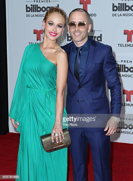Yandel and his wife Edneris Espada Figueroa are seen arriving to the Billboard Latin Music Awards at the Bank United Center on April 28 2016 in Miami...