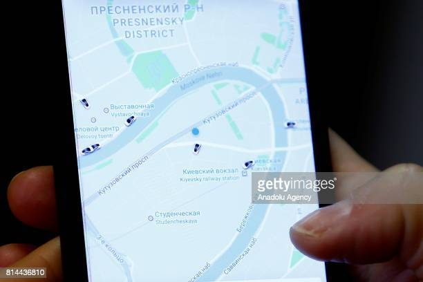 Yandex application is being displayed on a mobile phone's screen in Moscow Russia on July 142017 Uber and Yandex the 'Google of Russia' have agreed...