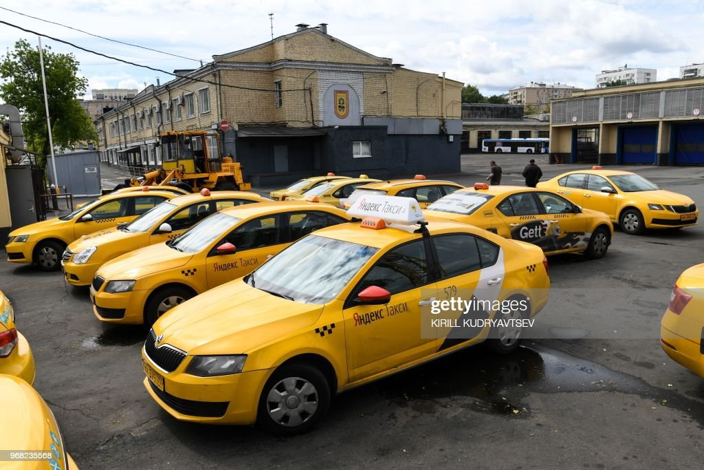 Yandex Taxi cars and a Gett taxi car are seen parked in