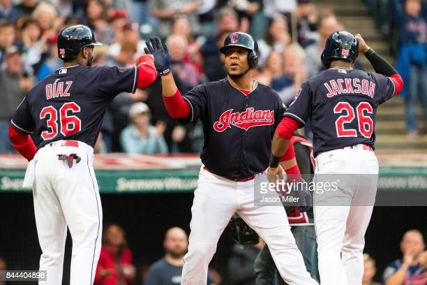 Yandy Diaz and Austin Jackson celebrate with Edwin Encarnacion of the Cleveland Indians after all scored on a home run by Encarnacion during the...