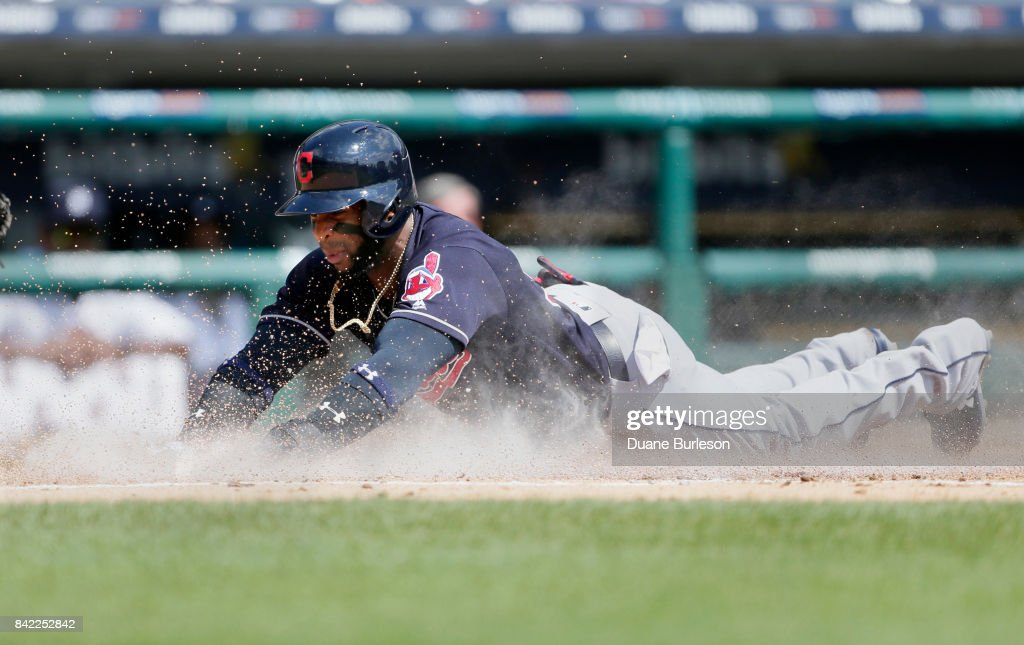 Yandy Diaz #36 of the Cleveland Indians slides into home plate to score from second base on a single by Roberto Perez of the Cleveland Indians during the second inning of the game against the Detroit Tigers at Comerica Park on September 3, 2017 in Detroit, Michigan.