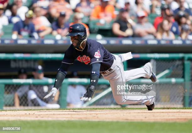 Yandy Diaz of the Cleveland Indians slides into home plate to score against the Detroit Tigers during the second inning at Comerica Park on September...